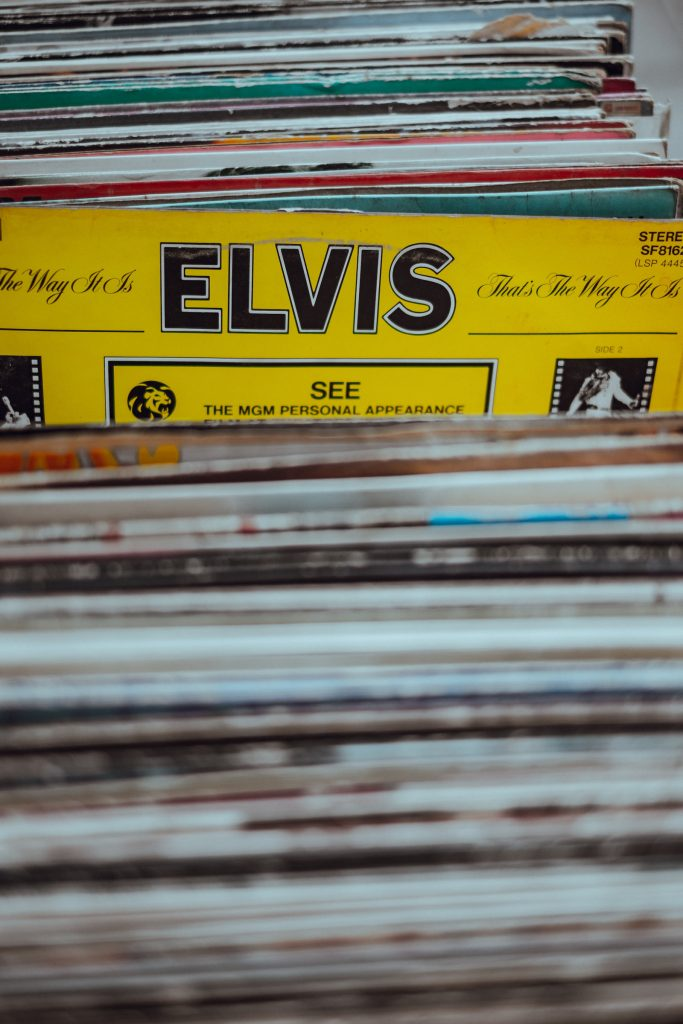 Stack of vinyl albums with Elvis shown